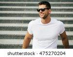 hipster wearing white blank t... | Shutterstock . vector #475270204