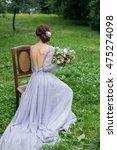 girl in elegant dress with...   Shutterstock . vector #475274098