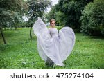 girl in elegant dress walking... | Shutterstock . vector #475274104