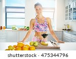 fit healthy young woman with a... | Shutterstock . vector #475344796