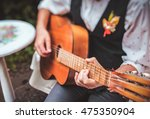 Close Up Finger Of Guitarist...