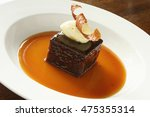 plated sticky toffee pudding | Shutterstock . vector #475355314