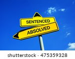 Small photo of Sentenced or Absolved - Traffic sign with two options - punishment or penalty after committing criminal act or be innocent and get absolution. Freedom and liberty vs imprisonment