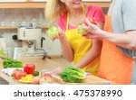 happy young couple cooking.... | Shutterstock . vector #475378990