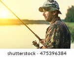 man fishes in the lakes of the... | Shutterstock . vector #475396384