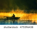 man fishes in the lakes of the... | Shutterstock . vector #475396438