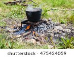 cooking on a camp fire outdoors ... | Shutterstock . vector #475424059