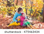 Mother And Kids Play In Autumn...