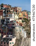 Small photo of view of a coastal village in Italy , accumulation of colored houses above the cliff