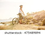 woman on vacation biking at... | Shutterstock . vector #475489894