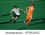 BLOEMFONTEIN, SOUTH AFRICA -  JAN. 16: Action during an international menas field hockey game between Germany and Netherlands (Netherlands won 2-1), Bloemfontein, South Africa, 16 January 2010 - stock photo