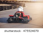 boy driving go kart car with... | Shutterstock . vector #475524070