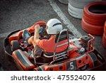 men driving go kart car with... | Shutterstock . vector #475524076