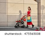 fashionable modern mother on a... | Shutterstock . vector #475565038