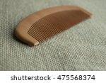 closeup brown wooden comb on... | Shutterstock . vector #475568374