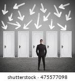 concept of businessman choosing ... | Shutterstock . vector #475577098