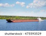 river tugboat moves cargo barge ...   Shutterstock . vector #475593529
