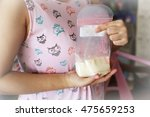 mother holding milk storage... | Shutterstock . vector #475659253