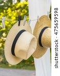 Image Of Straw Hats Hanging On...