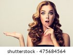 woman surprise showing product .... | Shutterstock . vector #475684564