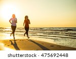 two women running on beach  | Shutterstock . vector #475692448