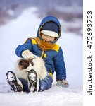boy plays with a cat outdoors... | Shutterstock . vector #475693753