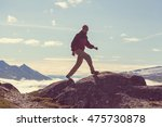 hiking man in the mountains | Shutterstock . vector #475730878