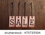 sale label on wooden background | Shutterstock . vector #475735504