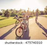 happy family is riding bikes... | Shutterstock . vector #475740310