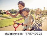 happy family is riding bikes... | Shutterstock . vector #475740328