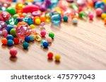 cheerful mardi gras beads in... | Shutterstock . vector #475797043
