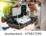 fiber optic technicians are... | Shutterstock . vector #475817290