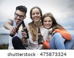 three friends toasting with... | Shutterstock . vector #475873324