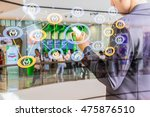Small photo of Mobile banking concept. The ATM - Mobile integration banking or cardless banking system, double exposure of man using smart phone with blank screen with social network icons and blur ATM background.