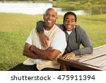 african american father and son | Shutterstock . vector #475911394