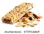 Stock photo muesli bar on heap of fruit seeds and nuts 475916869