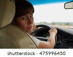 woman driving a car | Shutterstock . vector #475996450