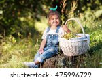 little girl in the woods with a ... | Shutterstock . vector #475996729