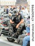 brutal biker with the phone. st.... | Shutterstock . vector #476069998