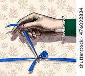 woman's hand untying bow of... | Shutterstock . vector #476092834