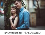 young and happy couple hugging... | Shutterstock . vector #476096380