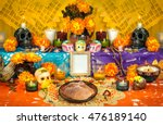 Stock photo traditional mexican day of the dead altar with sugar skulls and candles 476189140