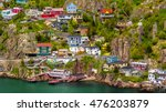 Aerial view of beautiful colorful houses built on the rocky slope of the Signal Hill in St. John