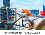 Offshore oil and gas industry, oil rig worker inspect and setting up top side tools for safety first to perforation oil and gas production well. - stock photo