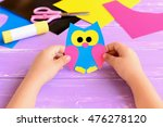 Small Child Holds Paper Owl In...
