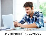 handsome young man in plaid... | Shutterstock . vector #476295016