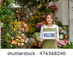 cheerful young flower shop... | Shutterstock . vector #476368240