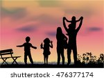 silhouette of a happy family in ... | Shutterstock .eps vector #476377174