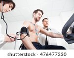 doctor and nurse assist the... | Shutterstock . vector #476477230