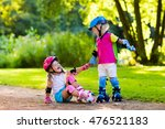 girl and boy learn to roller... | Shutterstock . vector #476521183